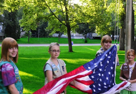 Girl Scouts raising the American flag