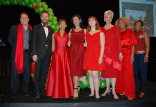 Go Red champions model red dresses by LA designers