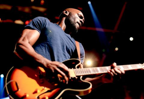 Guitarist Tyrone Carreker performs with recording artist Sam Hunt onstage during the 2015 iHeartRadio Country Festival at The Frank Erwin Center on May 2, 2015 in Austin, Texas. The 2015
