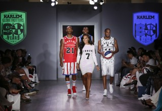 Designer Angela Simmons and Harlem Globetrotters Smooth Staples (red jersey), Thunder Law (behind Simmons) and Cheese Chisholm (white jersey) walk the runway during the finale of the Angela Simmons Harlem Globetrotters-inspired collection, at the annual KIA STYLE360 showcase during New York Fashion Week, Tuesday, Sept. 15, 2015, New York, N.Y. (Photo by Stuart Ramson/Invision for Harlem Globetrotters/AP Images) (PRNewsFoto/Harlem Globetrotters)