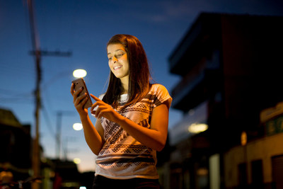 Winny Moreira, 17, uses her mobile phone on a street in Taiobeiras, Brazil. UNICEF is launching two new mobile initiatives to help protect vulnerable children in Brazil and around the world. © UNICEF/UN017602/Ueslei Marcelino (CNW Group/UNICEF Canada)