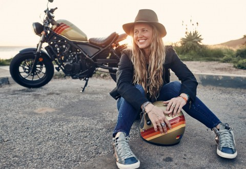 Aviator Nation founder Paige Mycoskie with her custom-designed 2017 Aviator Nation + 2017 Honda Rebel Motorcycle